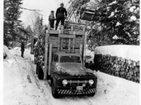 loading truck with cherry picker  1951
