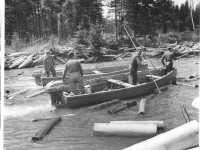 working wood with 2 motor boats